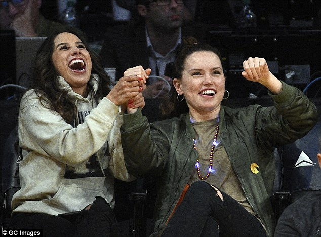 Happy: The on-screen star was evidently enjoying herself as she cheered and clapped throughout the game