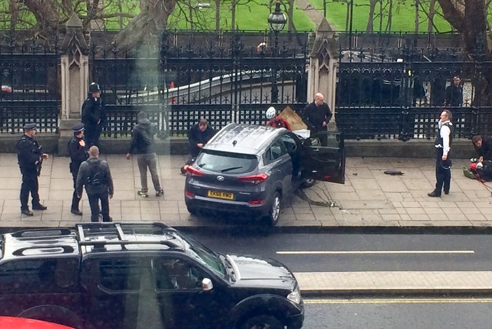 Armed Police have opened fire and shot a person outside the Houses of Parliament. A vehicle was seen on social media to have crashed into the fence of the palace