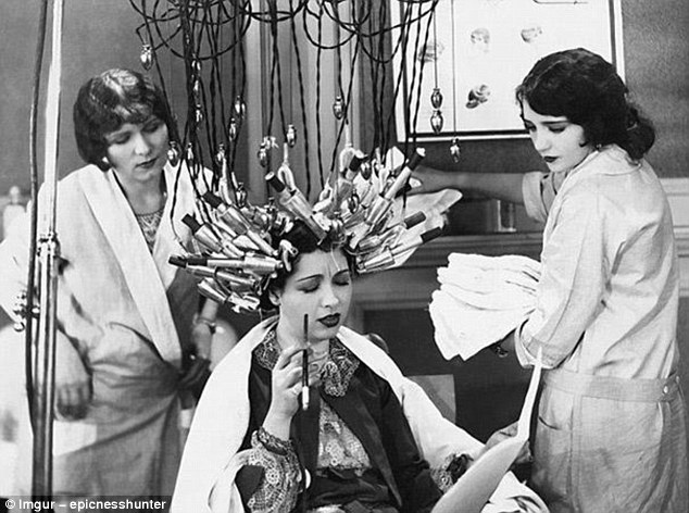 To get the tightly curled style of the day, pre-war women would spend hours having each section of hair individually set with the help of contraptions made of dozens of heating tongs