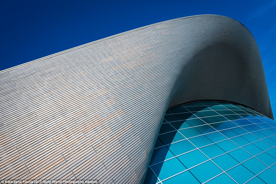 The London Aquatics Centre was designed by Pritzker Prize-winning architect Zaha Hadid in 2004 before London won the bid for the 2012 Summer Olympics. The photographer who took this image, Katarzyna Young, said of it: 'I tried to capture the signature curves of Zaha Hadid's architectural designs. My eye was also drawn to the vivid colour of the building's windows as well as on how the shadows and light define the structure'