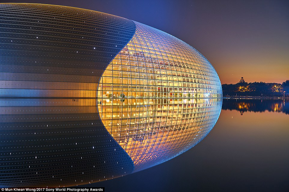 A reflection of the National Centre for the Performing Arts, Beijing, during sunset