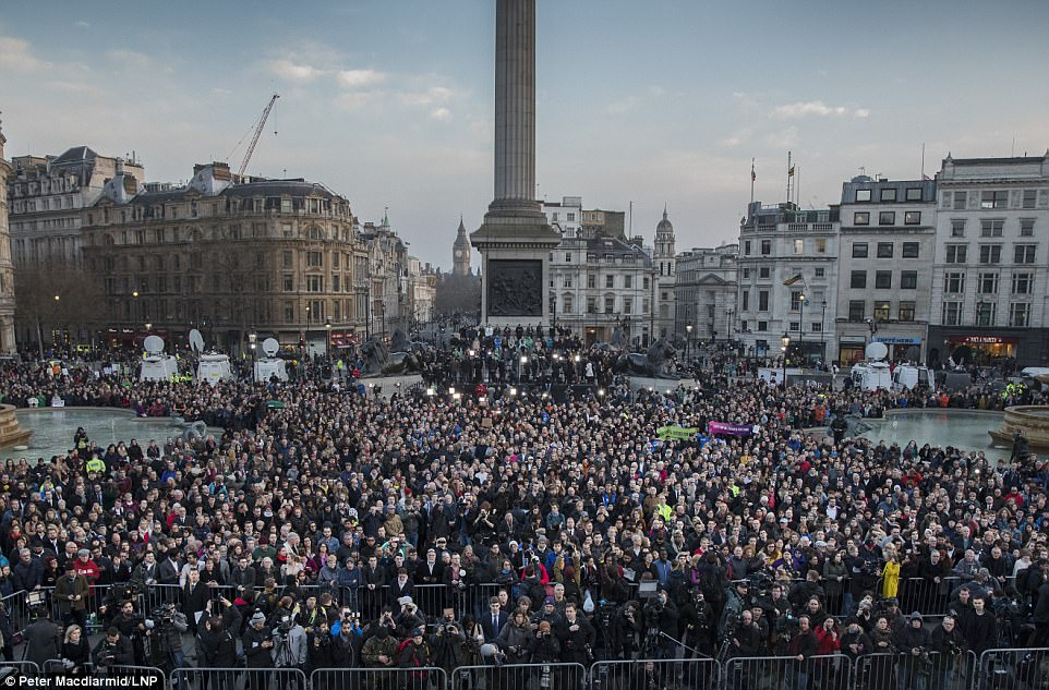 We are not afraid: Hundreds of defiant Londoners gathered in Trafalgar Square tonight for a candlelit vigil to remember the Westminster terror attack victims