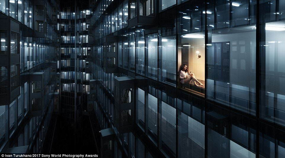 Here's Moscow looking like a city from the future, where photographer Ivan Turukhano caught a girl sitting by a window in a courtyard