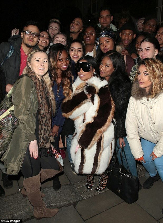 Fan favourite: The 34-year-old posed with a group of fans who had gathered outside her hotel