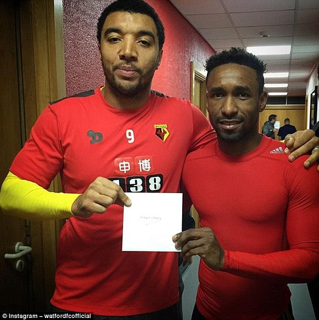 Watford captain Troy Deeney presents a Christmas card for Bradley to his best friend Defoe