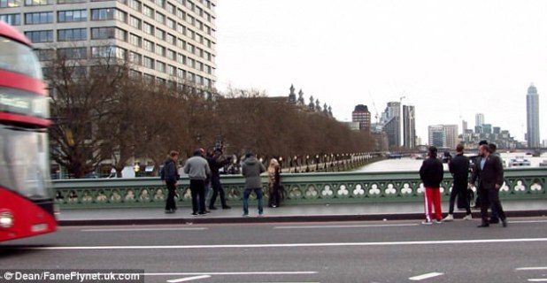 Iconic: A crew captured her every move as she performed on the bustling city's iconic bridge