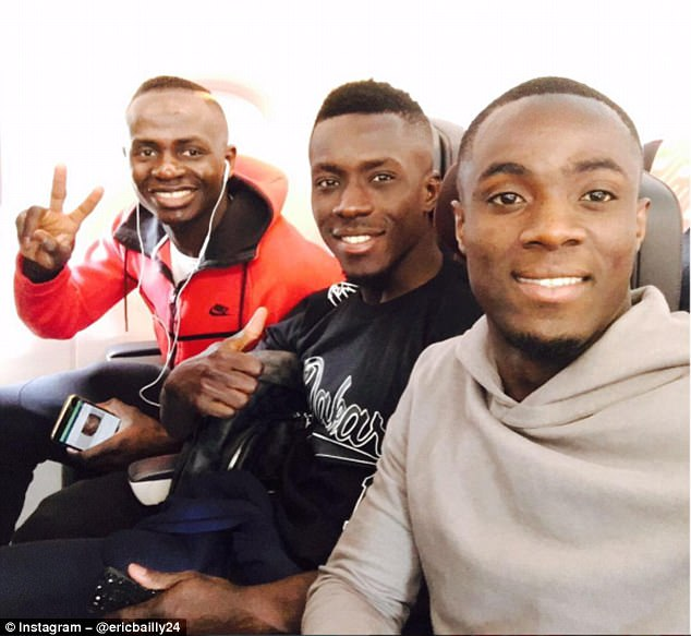 (L-R) Senegalese pair Sadio Mane and Idrissa Gueye join Eric Bailly on flight back to the UK
