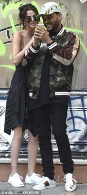 So in love: The singer, 24, appeared utterly smitten with her musician beau, 27, with the pair packing on the PDA and giggling away as they wandered around the city