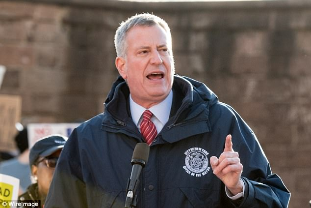 Despite New York City Mayor Bill de Blasio's proclamation that NYC is a 'sanctuary city,' the New York Daily News found out that the NYPD has told federal immigration officials about immigrants facing deportation who are due to appear in court. Pictured: De Blasio