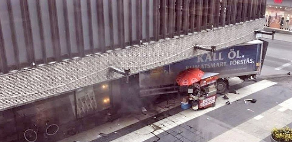 The back of the truck, sticking out of the shopping centre, is seen here