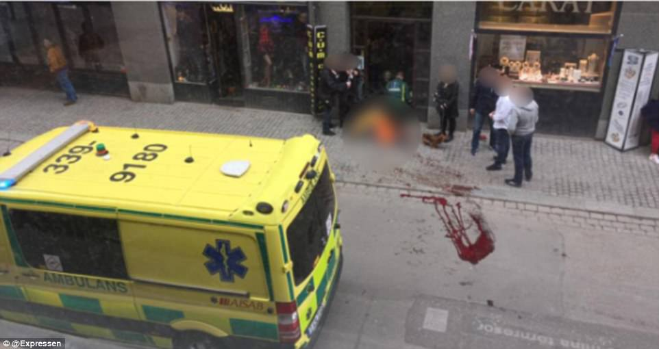 Blood was seen on the streets outside of the shopping centre where five people are said to have been killed