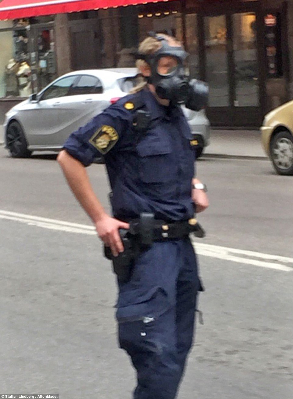 A policeman was seen wearing a gas mask in the city centre