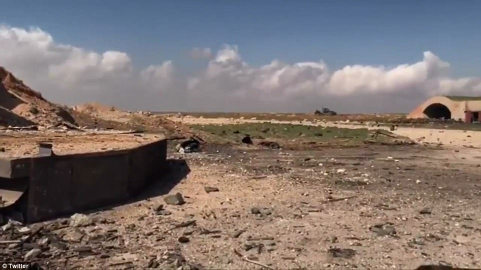 Shattered: Pictures show shards of shattered concrete strewn across the airfield at the Syrian military base this morning. The Syrian Army called it an 'act of 'aggression'