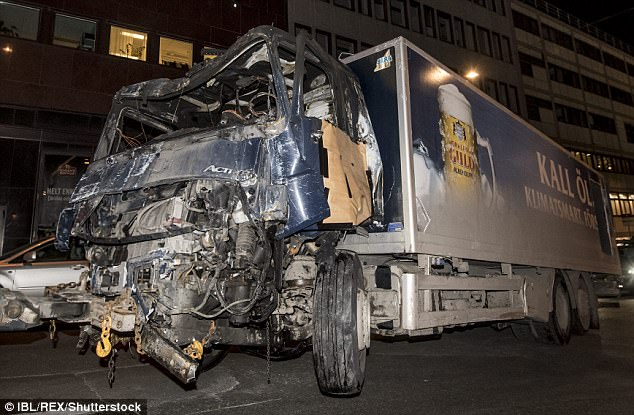 Destruction: Akilov left 15 wounded after ploughing a stolen beer truck, above, through crowds of people in one of the Swedish capital's busiest shopping districts.