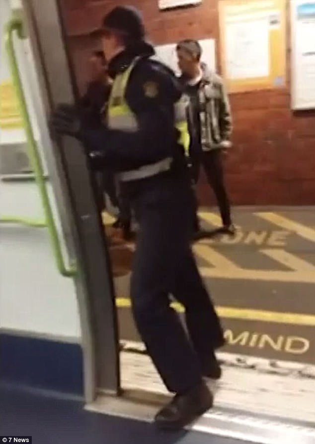 The witness said the African man told the three other men that all Arabic people were part of ISIS, and that's when the physical fight began. Transit officers boarded the train (pictured) when it stopped at Tottenham station