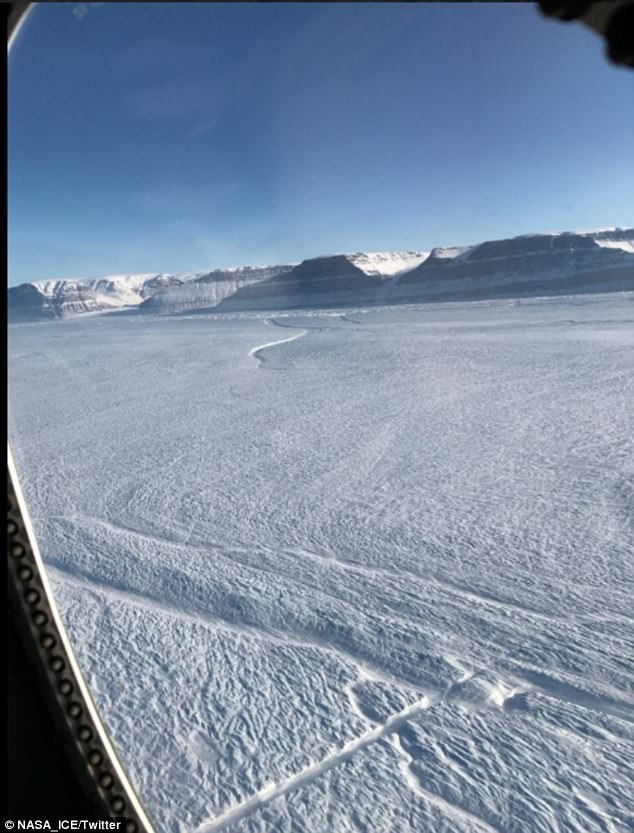 Pictured is part of the new rift on Petermann Glacier's floating ice shelf (shown near the bottom center). The older rift appears near top center. The shaded feature, near the bottom center, is the 'medial flowline' which may help slow the rift's growth