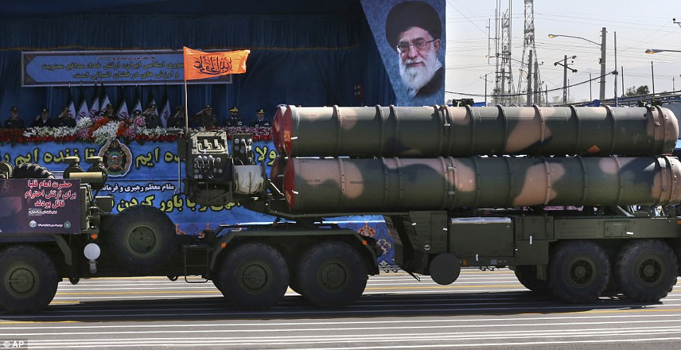 A Russian-made S-300 air defense system is driven past a portrait of Supreme Leader Ayatollah Ali Khamenei, during a parade marking National Army Day in front of of the late revolutionary founder Ayatollah Khomeini's mausoleum, just outside Tehran