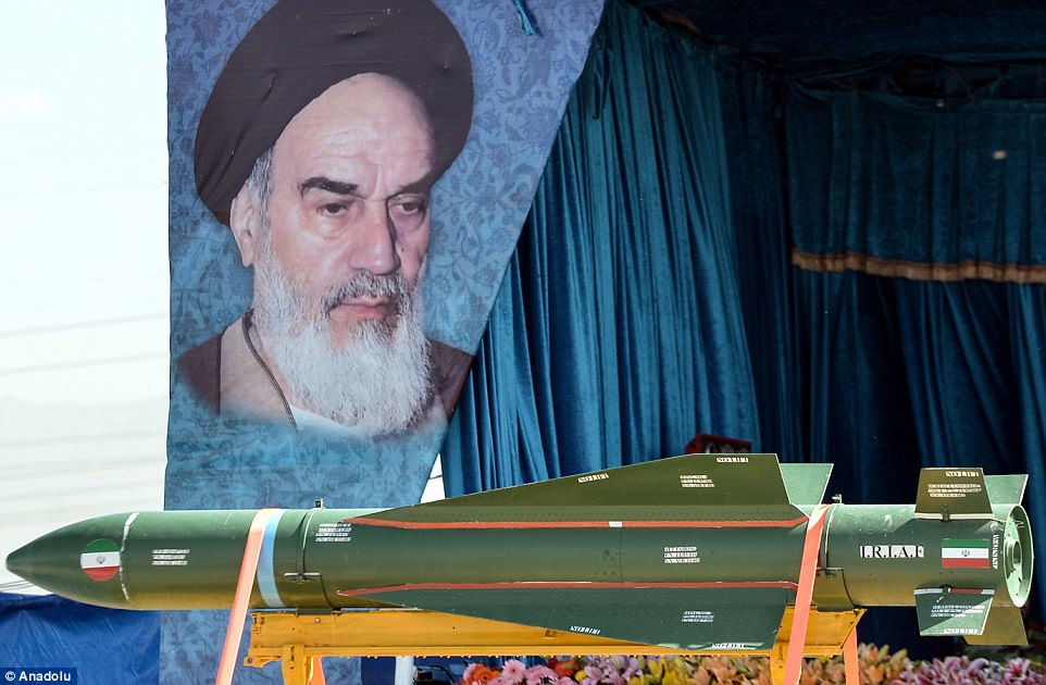 An Islamic Republic of Iran Air Force missile it taken by the grandstand in front of a display of flowers