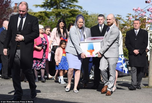Violet-Grace's parents Rebecca, pictured left, and Glenn, pictured right, led emotional mourners into the church as they carried their daughter's coffin
