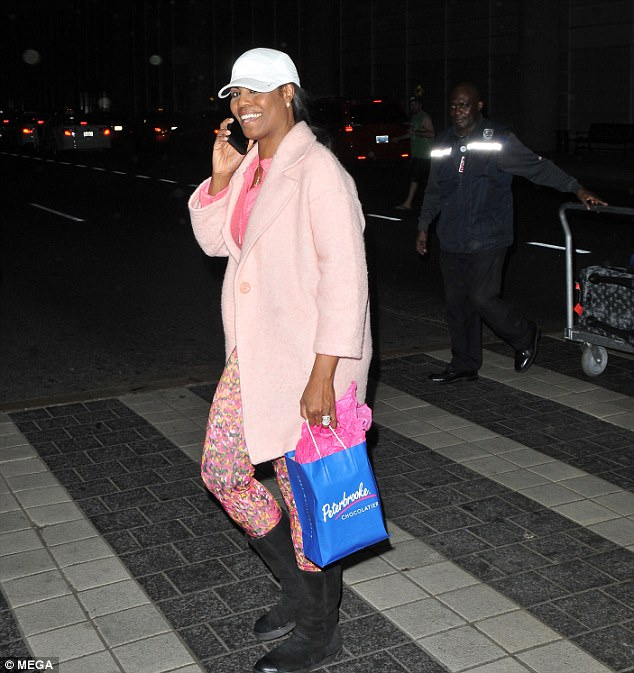 Home sweet home:Omarosa Manigault was photographed returning from her honeymoon in Italy late Sunday night (above)