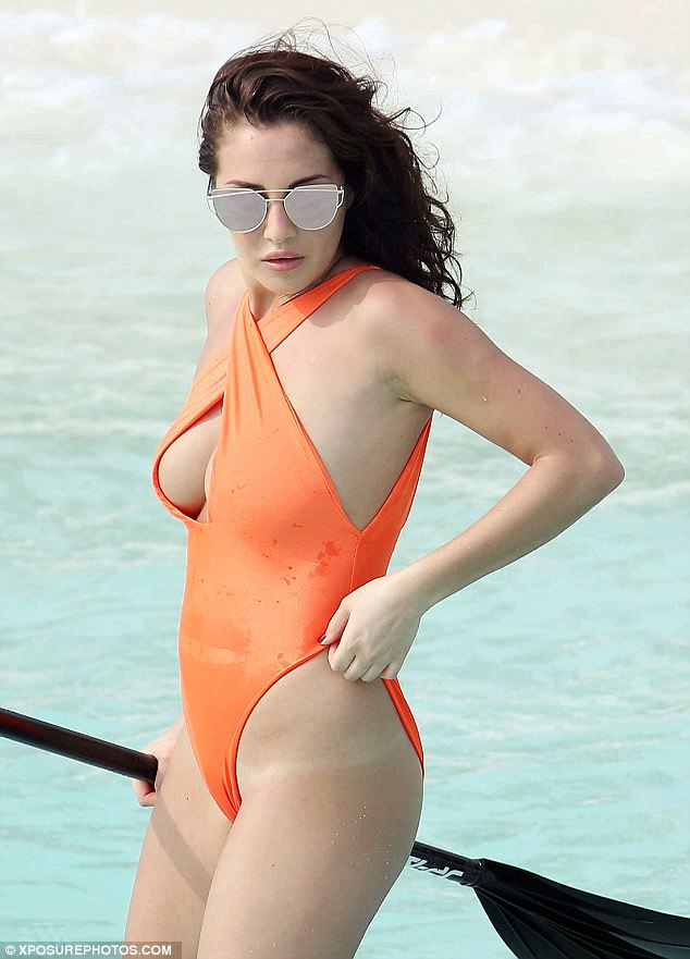 Sizzling: Chloe proved to be an absolute vision in the eye-catching swimwear which boasted a large sexy cut-out