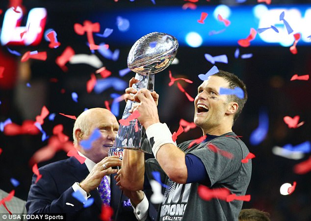 Glory days: Brady holding up the Super Bowl trophy after his fifth win with the Patriots this past February