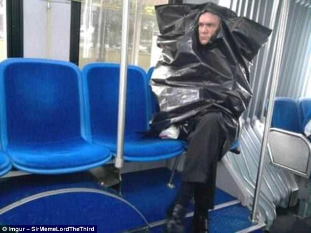 Confounding: A passenger whose glum expression is understandable, given that he is wearing a crumpled bin liner