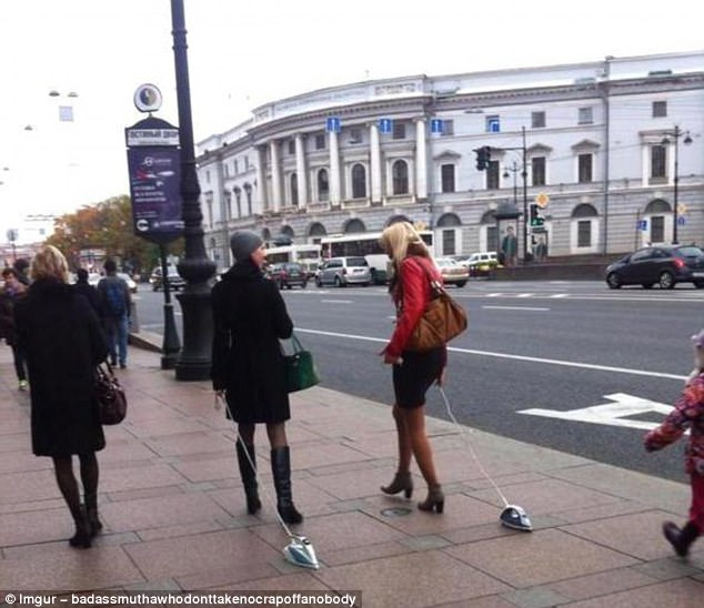 Walkies: All we know is that this snap was reportedly taken in Russia. Why these women are taking their irons for a stroll there remains the million dollar question