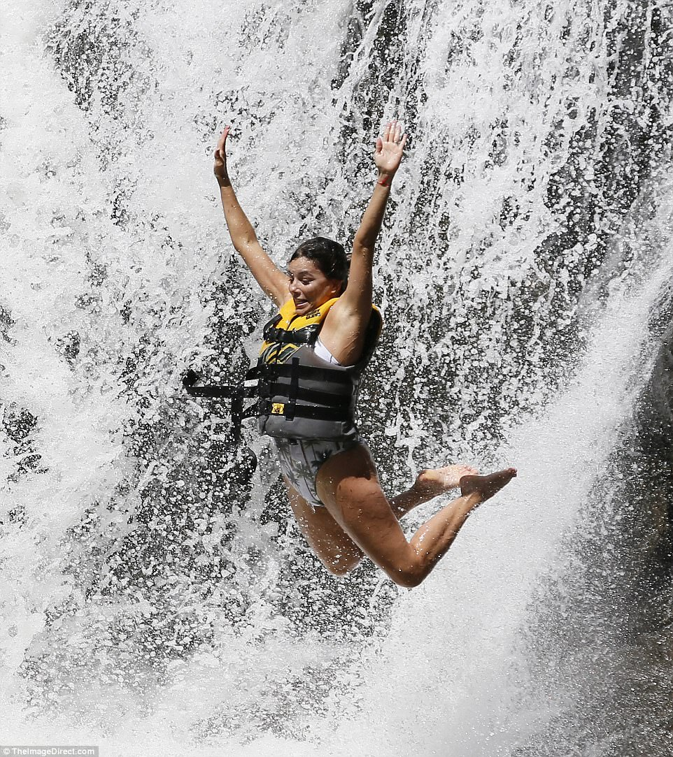 Down she goes! The star flew through the air with her arms and legs outstretched and the stunning waterfall as a backdrop