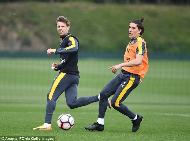 Full-backs Hector Bellerin and Nacho Monreal vie for the ball at London Colney