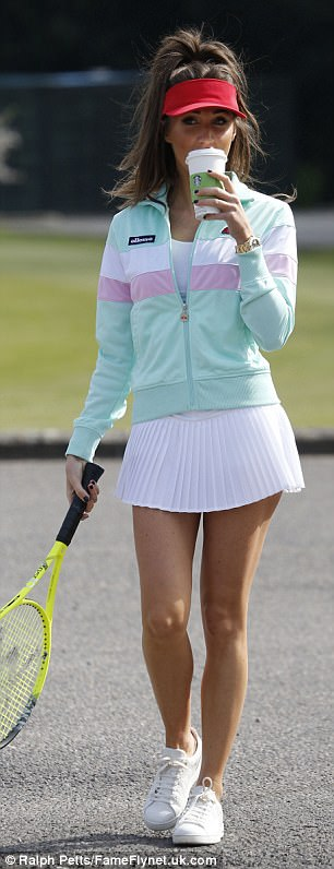 Coming prepared: She donned a pair of comfortable white trainers as she held onto her yellow racket