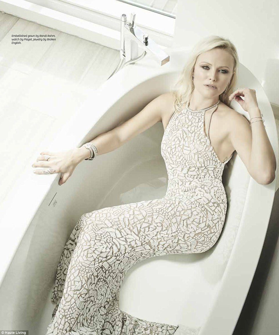 Bath time: She rocked a full length metallic embellished gown designed by Randi Rahm