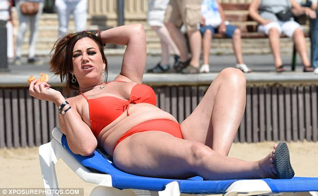 Tucking in: The ex Big Brother star indulged in a snack as she kicked back on the sand