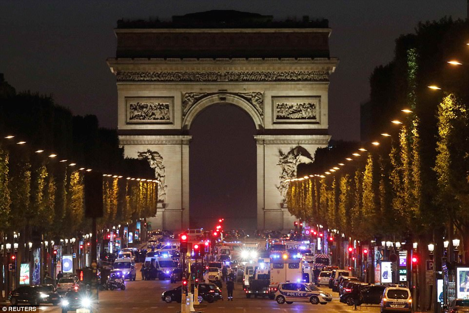 A French police officer has been shot dead on the Champs Elysees in Paris (pictured) - just days before the French presidential election