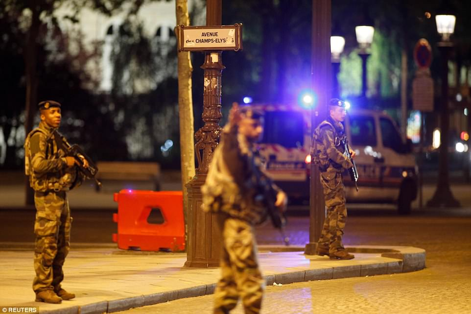 Armed soldiers secure the Champs Elysees Avenue after a police officer was killed when a gunman opened fire in Paris