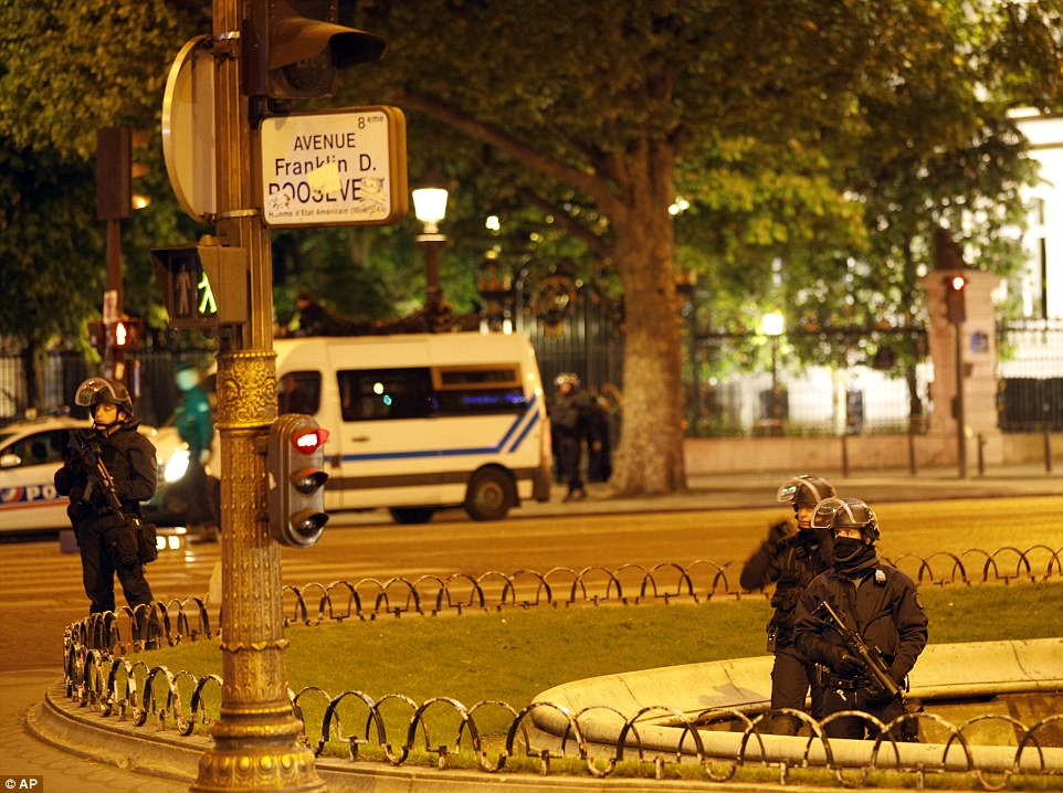 Police officers took positions near the Champs Elysees avenue in Paris after a fatal shooting which left one police officer dead