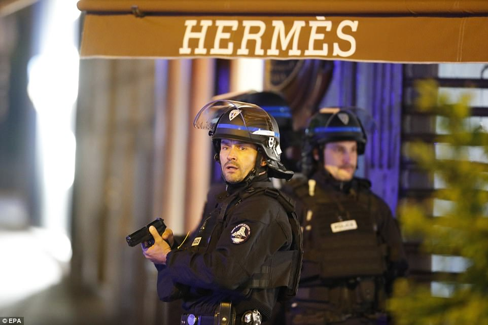 French police officers reacted after the shooting which left one officer dead and two more seriously injured in Paris