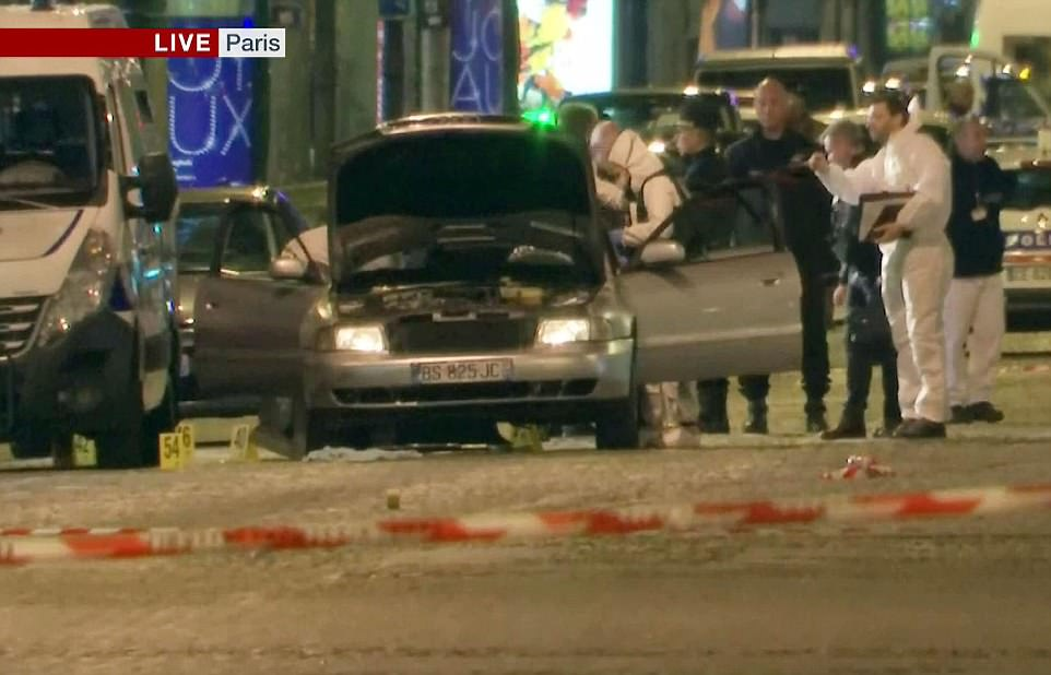 French police officers and forensic teams searched a vehicle which was close to the scene on the Champs Elysees in Paris
