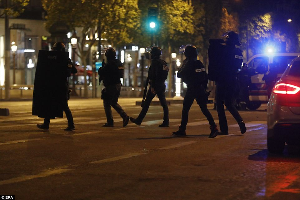French police officers searched the area after some of their colleagues were shot in the heart of Paris on Thursday evening