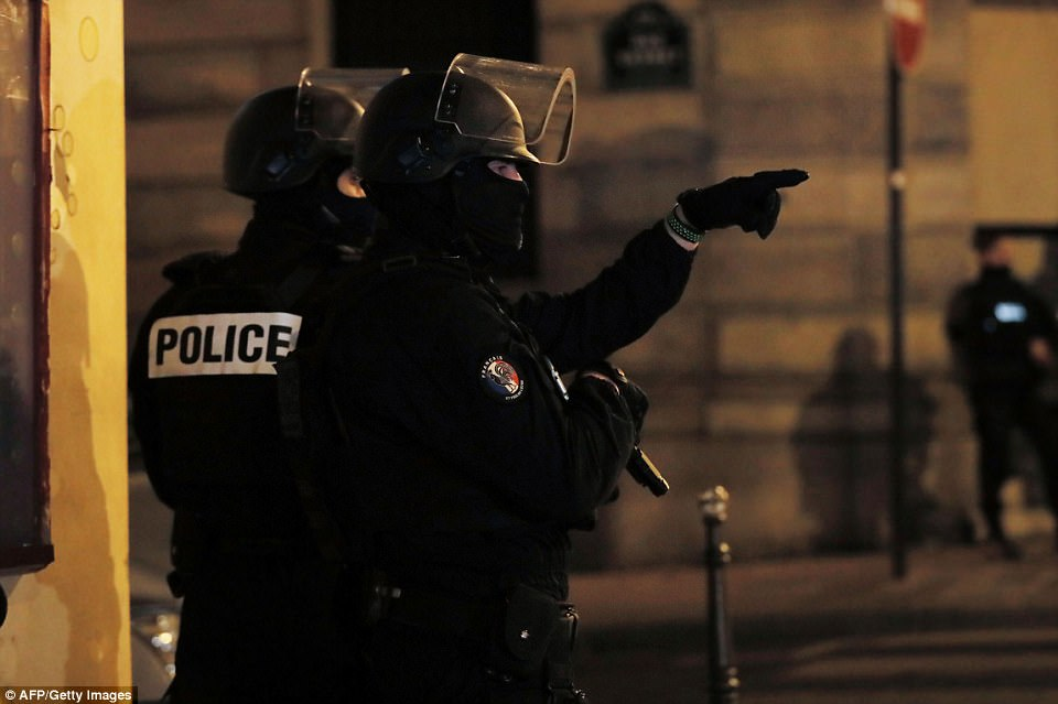 Police officers blocked the access of a street near the Champs Elysees in Paris after the fatal shooting on Thursday, April 20