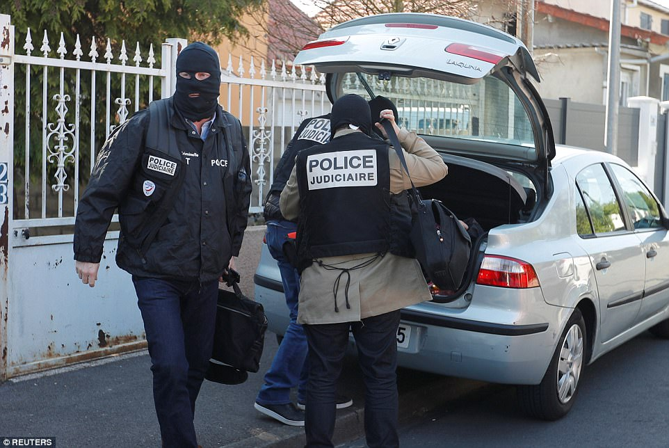 French police leave the home of ISIS gunman Karim Cheurfi in the suburb of Chelles, in Paris, following last night's attack
