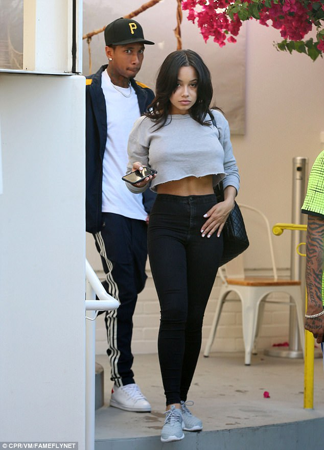 The pictures that will break Kylie's heart! Tyga embraces Jenner lookalike after split