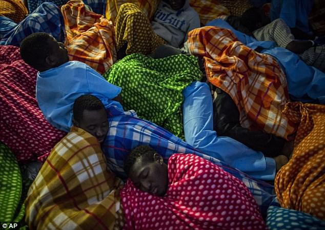 Refugees and migrants rested on the Golfo Azurro after being rescued off the Libyan coast in February 2017