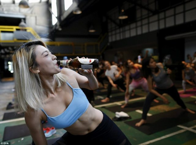 Yogi stop mid-pose to take a sip of beer. The movement, called 'Bieryoga' started in Berlin in 2015 and has spread to cities like Melbourne and Sydney