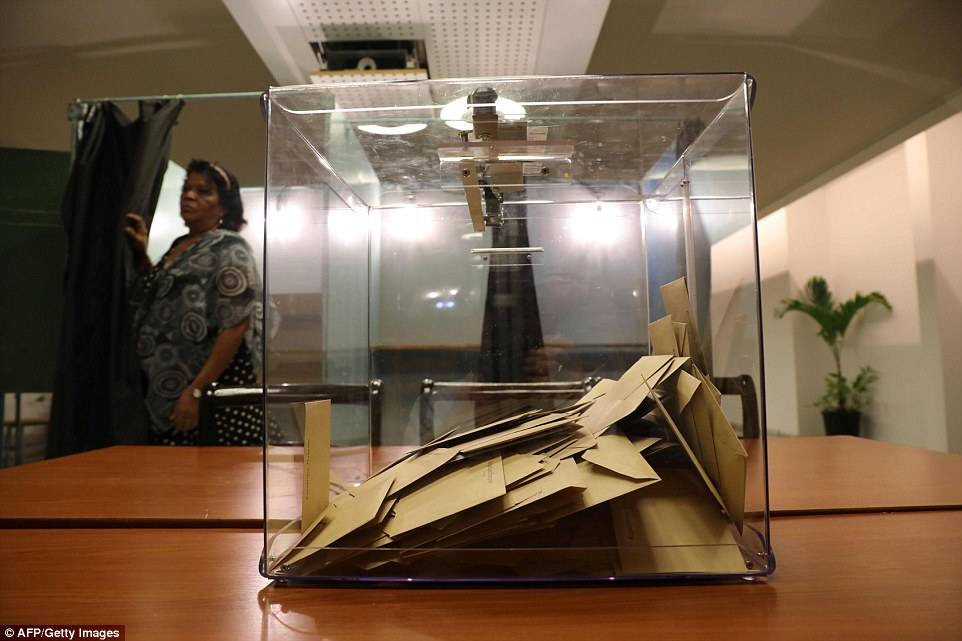 Ballot boxes in Le Port, on the French overseas island of La Reunion were seen locked after the polls closed earlier this evening