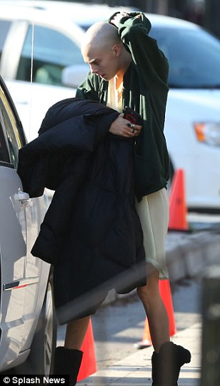 Big step: Carrying a chunky quilted coat in her arms however, the Hammersmith native cut a somewhat tired and strained figure as she emerged from her car for her day - following her drastic transformation