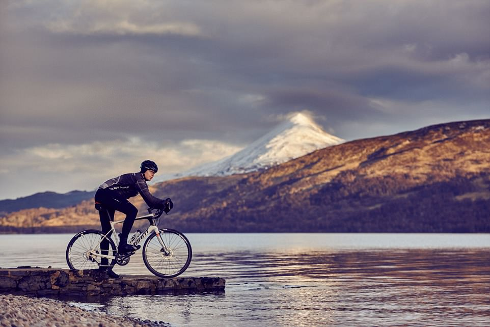 Stunning scenery: A cyclist poses during the Marie Curie Etape Caledonia — which returns to the Scottish Highlands next month, bigger and better than ever before for its 11th year