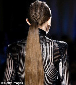 Great lengths: Gigi Hadid, 22, was one of the models in Balmain's fall 2017 show who wore extensions from the brand to fake a long ponytail