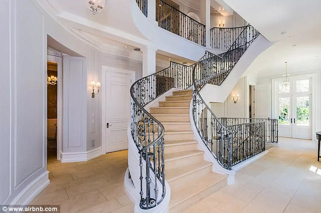 Started from the bottom! The elegant staircase is just one of the home's impressive features