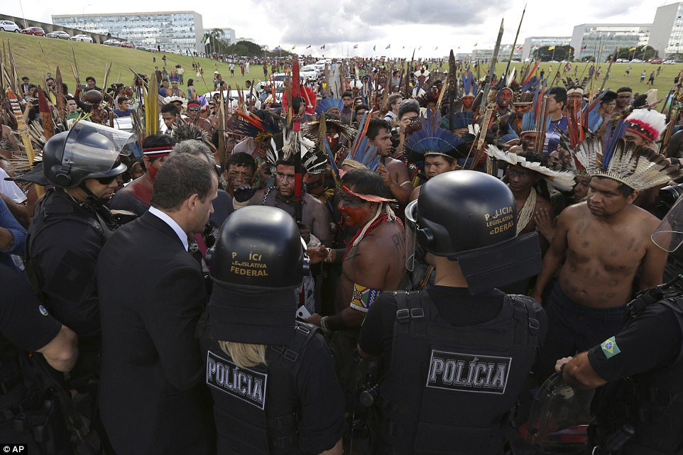 Indigenous from various ethnic groups negotiate with police as they protest in favor of the demarcation of indigenous lands outside the National Congress